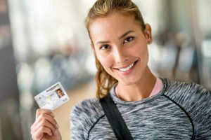 woman holding her electronic health insurance card